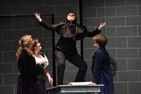 Igor (sophomore Grace Shuley) shows his excitement at the prospect of creating a monster in front of Inga (senior Zoe Zoller), Frau Blücher (senior Madi Burnett), and Dr. Victor Frankenstein (senior Hank Slaby).