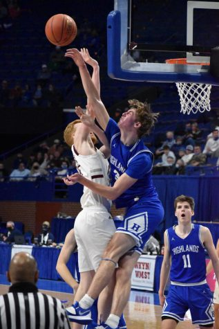 Senior Sam Vinson meets his competitor at the rim, blocking his attempted dunk.