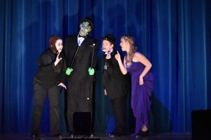 Igor (sophomore Grace Shuley), the Monster (sophomore Logan Holbrook), Dr. Frederick Frankenstein (senior Hank Slaby), and Inga (senior Zoe Zoller) put on a show for Transylvania.