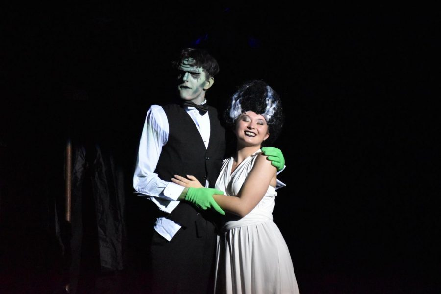The Monster (sophomore Logan Holbrook) poses with his bride, Elizabeth Benning (junior Ashley Kelly).