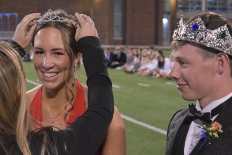 Macy Kocher is crowned as the junior Prom Queen while junior Prom King Abe Hils looks on.