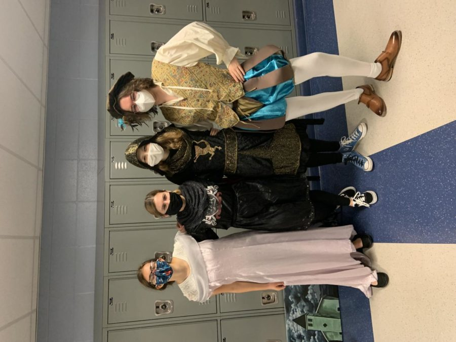 Seniors Allison Bertasso, Brynn Shannon, Lauren Jamie, and Samuel Contreras dress up in their 90s medieval outfits.