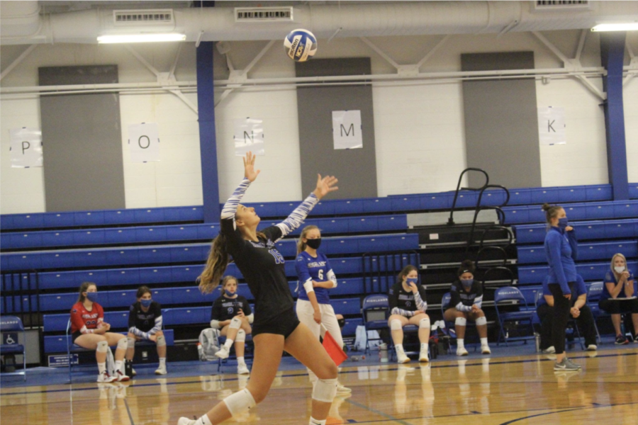 Senior Lauren Buemi jumps up to hit the volleyball back to Newport High School, during the the 2020-2021 season.