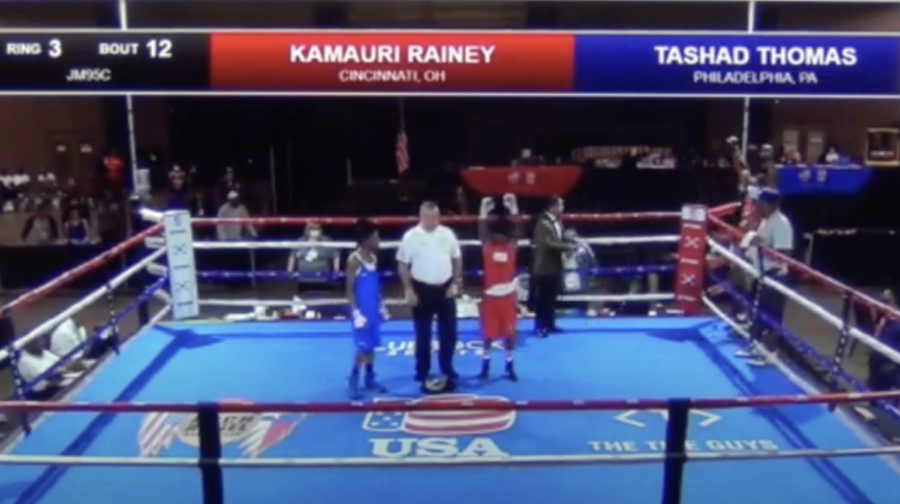 Sophomore Kamauri Rainey holds up his arms in victory after winning the USA National Boxing Junior Olympics.