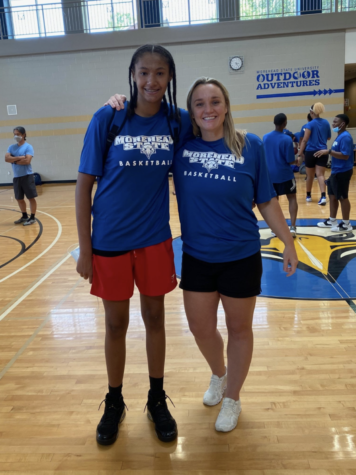 Standing with the coach who offered her the first scholarship, Freshman Marissa Green takes a quick picture with Cayla Petree, the Head Women's Basketball Coach at Morehead State University.