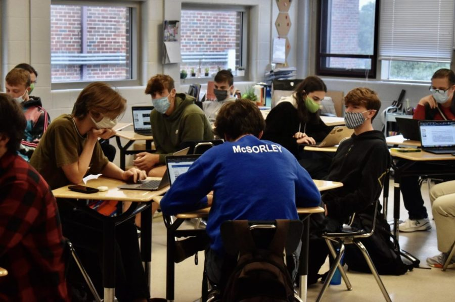 English Teacher Lauren Peterson's third-period class practice class safely with the new test to stay policies in place.