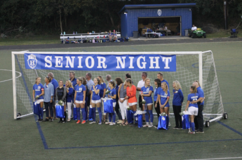 The seniors converse with their parents and friends during the Senior Night ceremony.