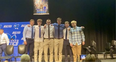 Seniors Austin Duncan, Zachary Barth, Oliver Harris, Cole Kocher, Abe Hils, and Layton Reed model with their championship rings.