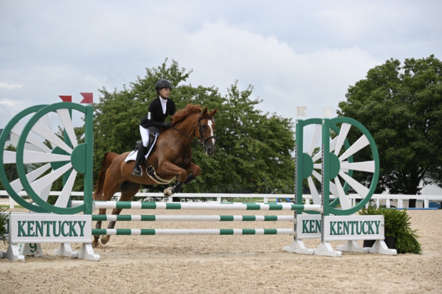 Junior Maggie Hahn jumping her competition horse, which is named Dutchess.