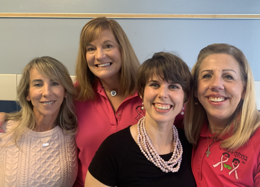 """Highlands Parents Michelle Bracken, Mary Schneider, teacher Beth Brubaker, and Chicks and Chucks Founder Cathy """"Chick Halloran"""" pose for a photo before doing an audio recording for the Pink Out game."""