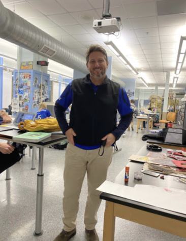 Radio show host and Highlands High School Art Teacher Andrew Eckerle smiles for the camera.