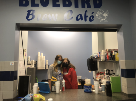 Seniors Honor Valentine and Savannah King stand in the Bluebird Cafe, preparing to begin working.